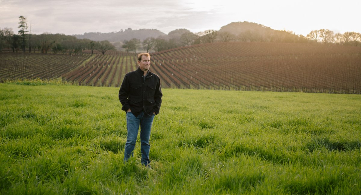 Winemaker, Graham Weerts standing in the Field Stone vineyard.